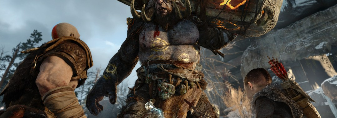 kratos holds a weapon and stands beside his son as they face a troll