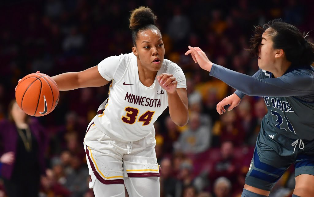 The Gophers are delighted to present the No. 13 jersey to women's basketball coach Lindsay Whelan Gadiva Hubbard