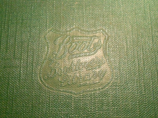 Embossed library crest on front of book