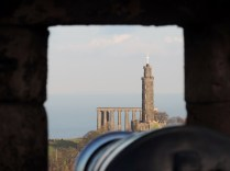 The Nelson Monument viewed through a cannon hole in Edinburgh Castle
