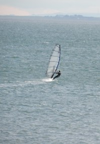 Windsurfer braving the surely still cold water