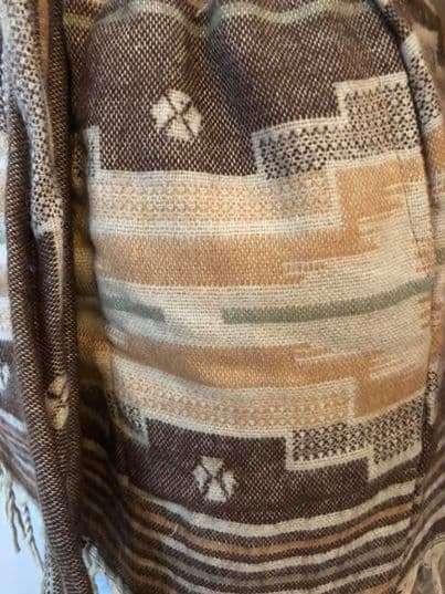 Heerlijk super-warm vest, in het beige en bruin.
