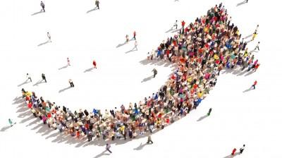 Large group of people symbolizing direction , progress,growth.