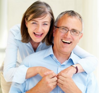 Portrait of romantic old couple having fun