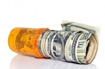 8532826-a-prescription-pill-bottle-with-rolls-of-cash-in-it--concept-or-metaphor-for-cost-of-drugs