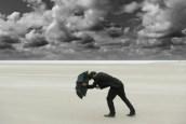man-withstanding-storm-w-umbrella