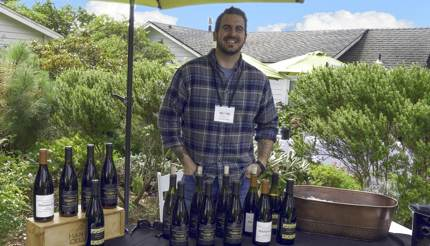 Man service Pinot Noir at Winesong Weekend in Mendocino County