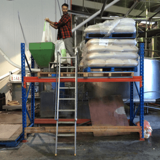 Taika, hard at the milling process for the Delicious Neck brew.