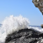 Wave explodes hitting rocks12