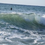 Big wave with surfers12