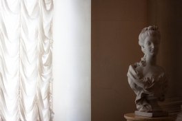 Statue next to a window at Saint Petersburg's State Hermitage Museum