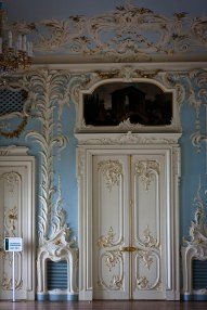 Chandeliers among ornate walls and ceilings in Saint Petersburg's State Hermitage Museum