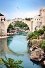 Stari Most, the old bridge of Mostar and the Neretva River that runs beneath it. Bosnia and Herzegovina.