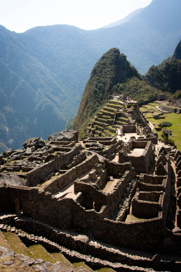 """The ancient Inca city, Machu Picchu. The small peak in the background is called """"Wayna Pikchu"""" -- if you are afraid of heights, don't climb it. :/"""