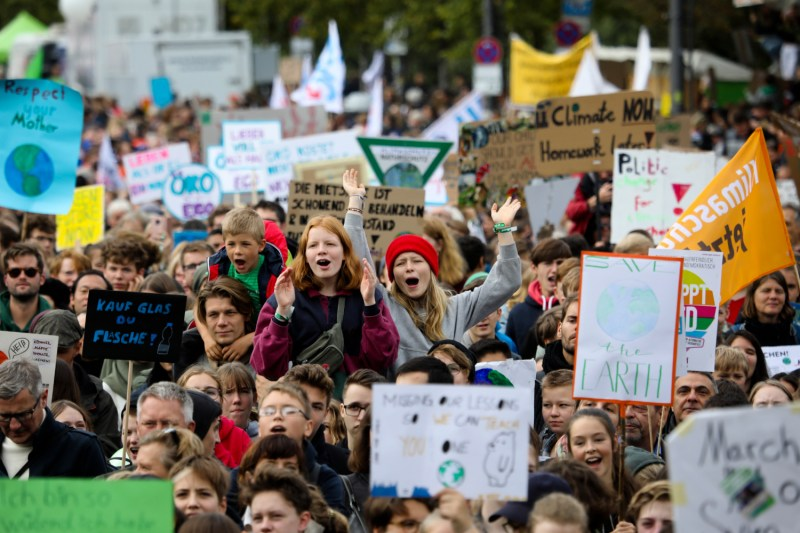 People attend a climate rally in Berlin.