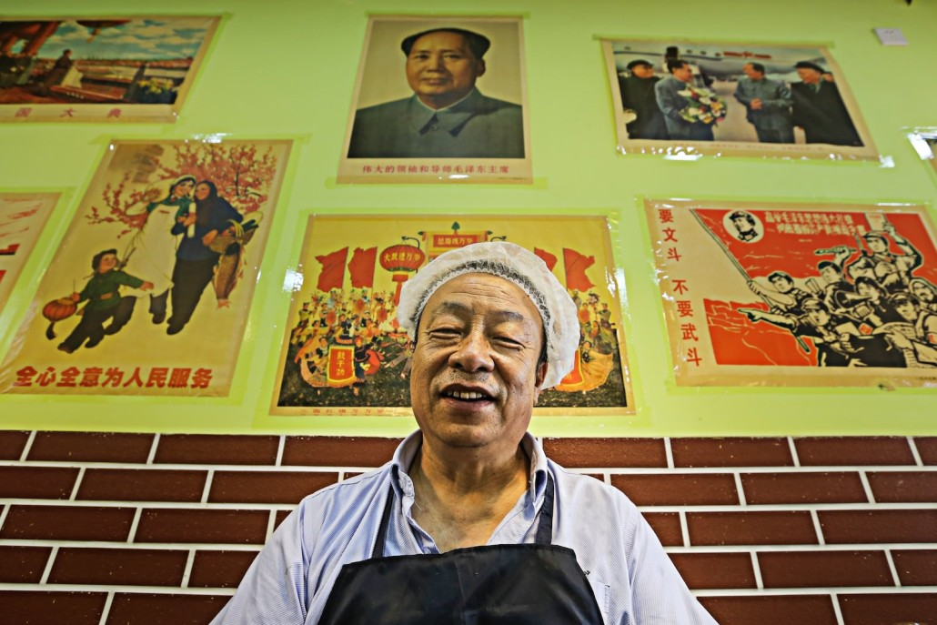 Proudly displaying his collection of cultural revolution era propaganda
