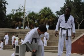 Breaking concrete for black belt test, age 12