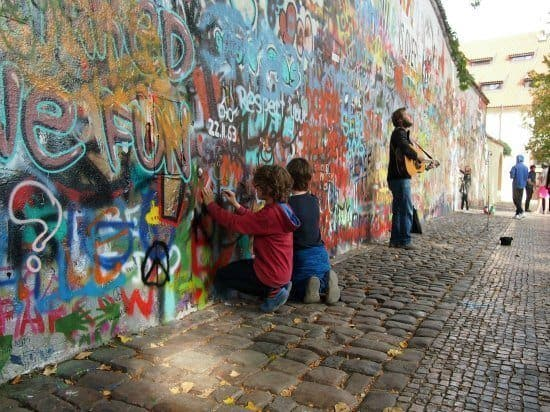 London to Romania by car. One of the highlights of Prague on our child-focussed city tour. Art at the Lennon wall as a busker played Imagine.