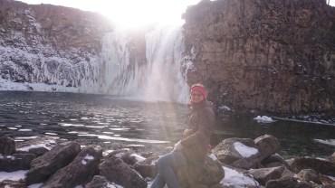 Half frozen waterfall with sunshine