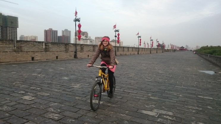 We rent bikes to ride on the old city wall of Xi'an