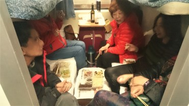 Chinese women sitting together in the train