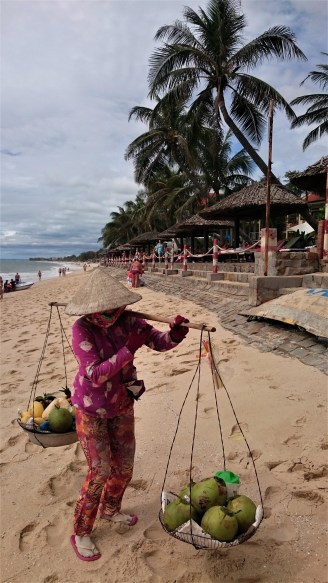 Typical Vietnam - women selling fruits on the beach