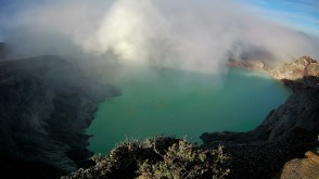 Ijen Crater Lake with yellow sulphur mine inside
