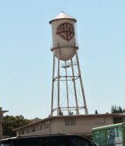 Water tower with the Warner Bros Studio logo on it