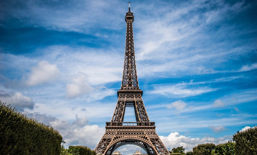 sunny blue skies behind the Eiffel Tower in Paris