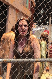Walking dead girl approaches the fence