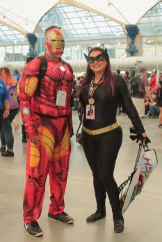 Iron man and Batgirl characters pose at comicon