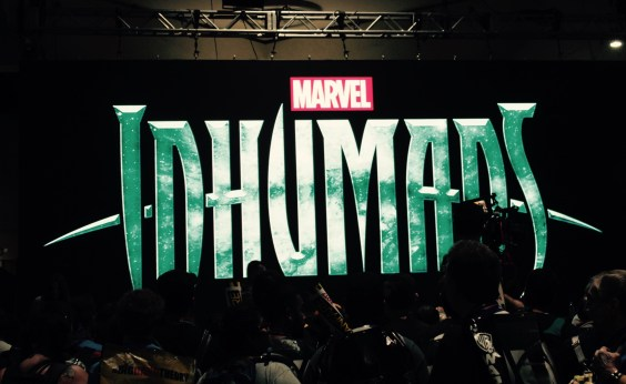 "Big sign saying ""Marvel Inhumans"" in green"