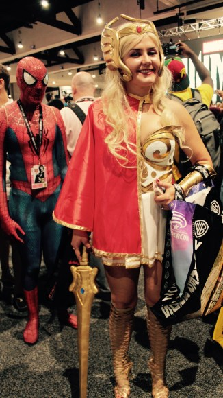 Shera character with gold sword and knee high lace up sandals