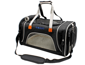 black pet carrier with two handles, a strap and a mesh screen on sides