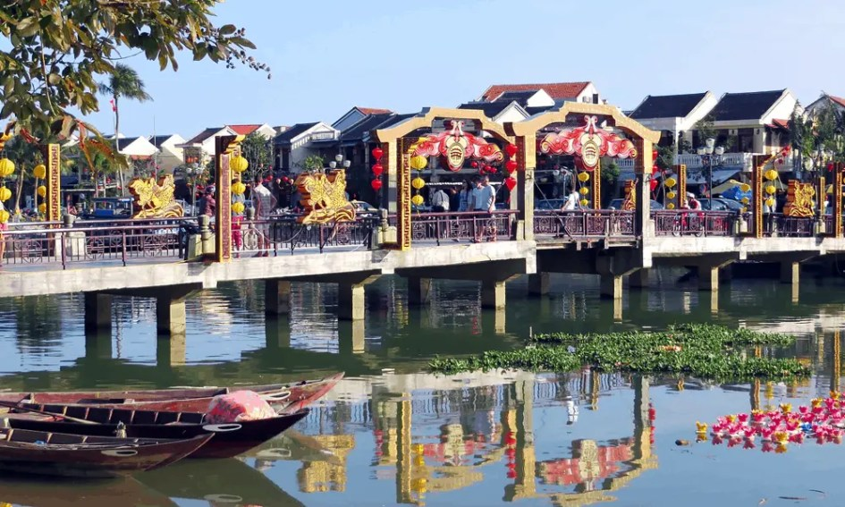 Depicts river and bridge in Hoi An, Vietnam - best Vietnam beaches