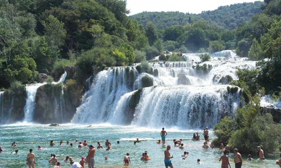 Best Zadar day-trips and Excursions - Shows people swimming at Krka National Park