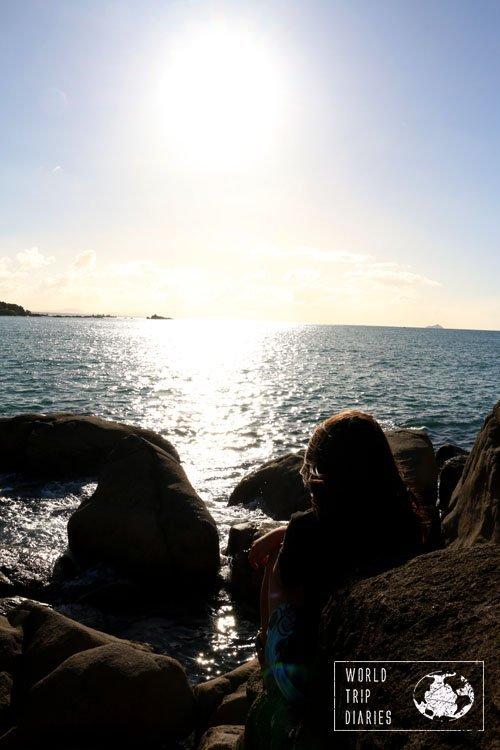 Joao resting at the rocks at Moturiki Island
