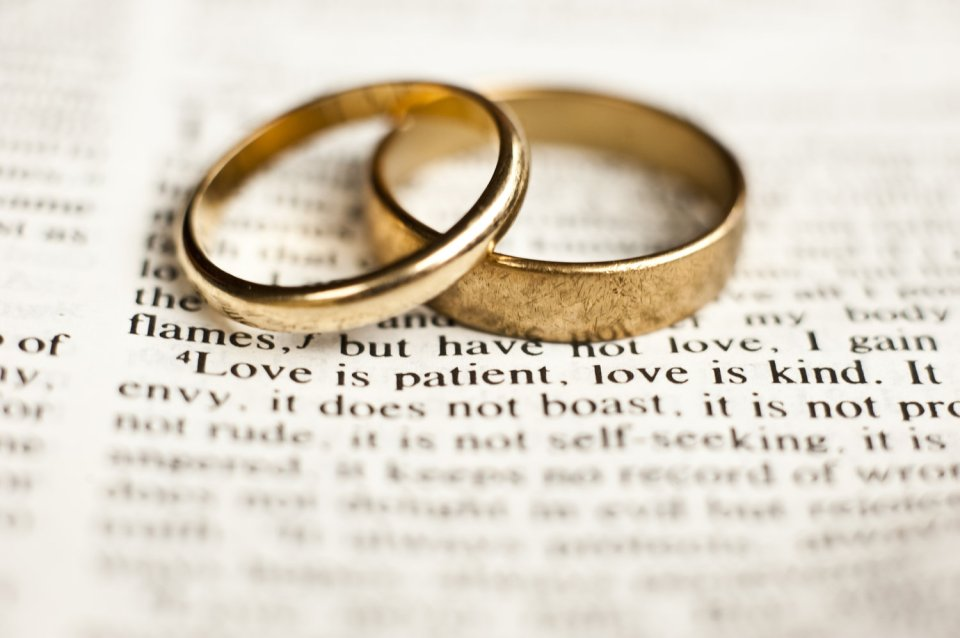 Image of two rings together represents marriage