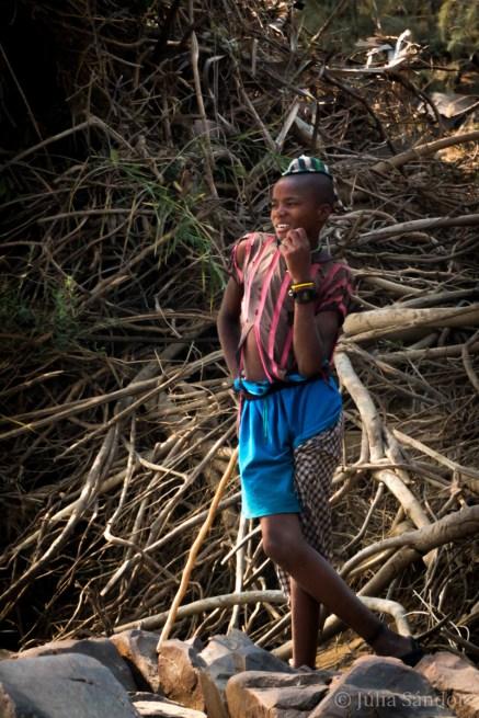 Himba boy at the riverside