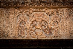 Teak wood carved Ganesha protecting the entrance