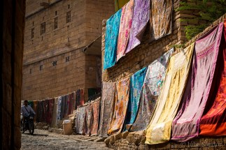 Beautiful textiles for sale on the entry road of the fort in Jaisalmer, India