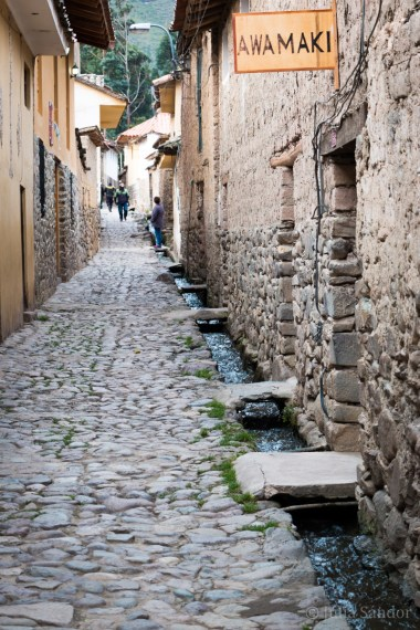 Narrow streets of Ollantaytambo. The channel system originates from Inca times.