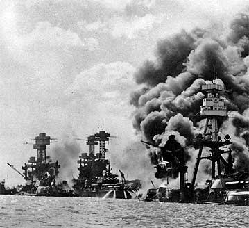Sunken USS West Virginia, the damaged USS Tennessee, and the sunken USS Arizona  in Pearl Harbor