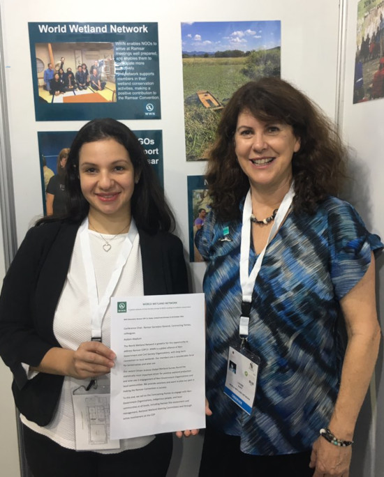 Two women pose at COP13
