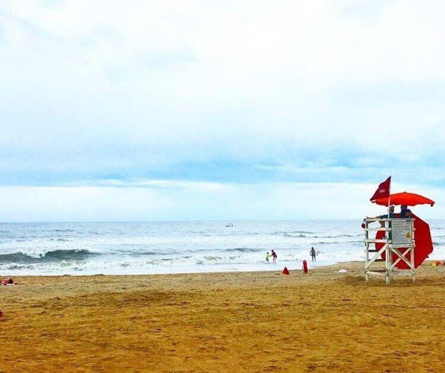 ocean and lifeguard umbrella on Virginia Beach