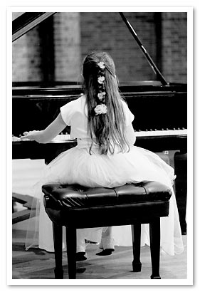 little girl taking a piano lesson at School of Music in Edison NJ.
