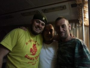 more crazy russians. this guy on the right was in the army fighting in ukraine. I borrowed his hat