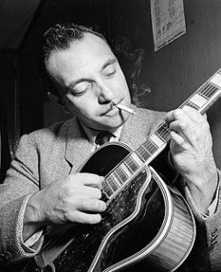 Django Reinhardt with guitar, smoking cigarette