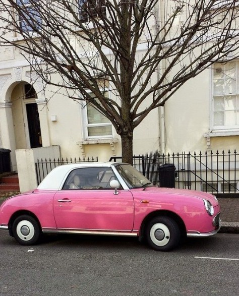Pink Nissan Figaro on Street