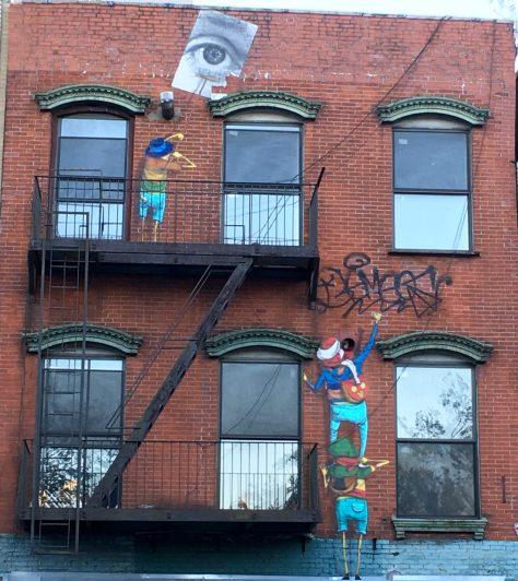 Os Gemeos and JR Mural